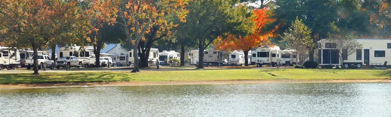 Fall foliage and lake at a campground with RVs